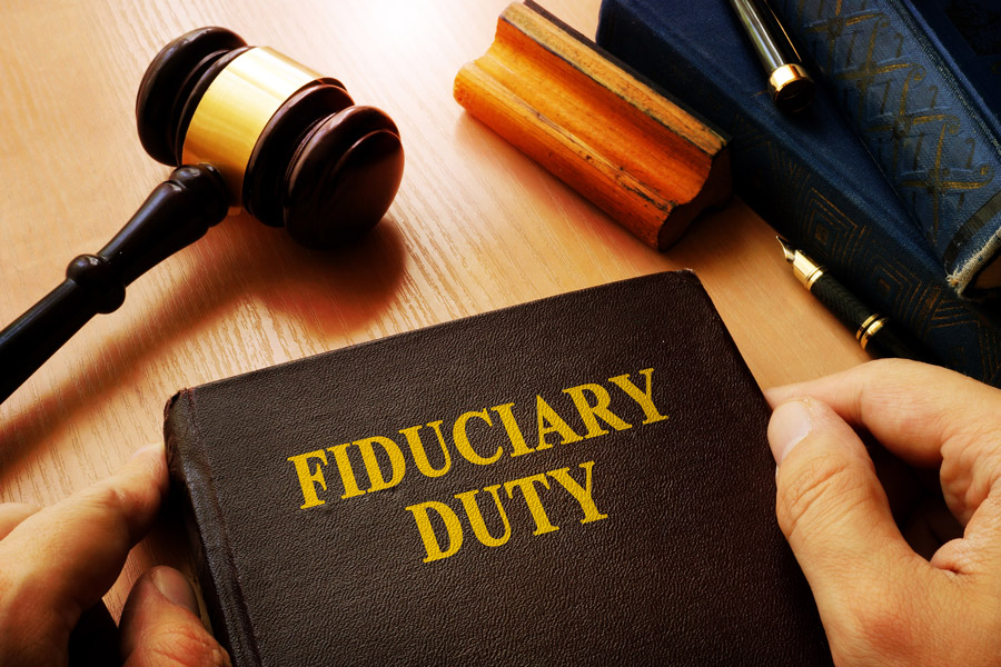 Fiduciary Duty book next to a gavel